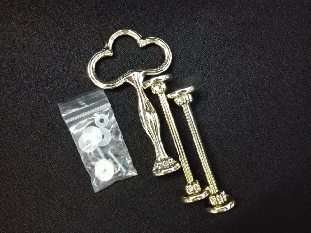 Náhradní kovový zlatý klíč k třídílnému etažéru